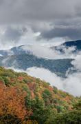 Layers of Fog and Mountains in Fall Vertical - stock photo