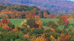 Flight over rural New England landscape in autumn - stock footage