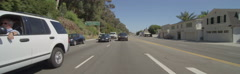 Rear view of a Driving Plate: Car travels on Highway 1 in Santa Monica, Stock Footage
