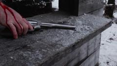Wounded Gunfighter Sets Bloody Revolver on Cabin Ledge Stock Footage