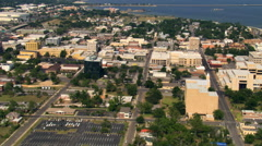 Flight over the city of Pensacola, Florida to water's edge. Shot in 2007. Stock Footage