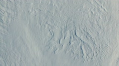4K. Flight and takeoff above snow fields in winter, aerial view with rotation. Stock Footage