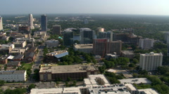 Aerial of skyscrapers and Lake Eola in Orlando, Florida Stock Footage