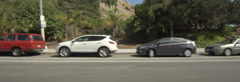Left Side view of a Driving Plate: Car traveling on Temescal Canyon Road in Stock Footage
