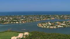 Aerial over residential islands and channels with motorboats Stock Footage