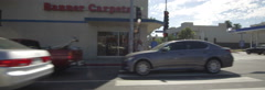 Left Side view of a Driving Plate: Car traveling on Lincoln Boulevard turns left Stock Footage