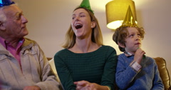 4K Family generations birthday party - whole family together with birthday cake  - stock footage