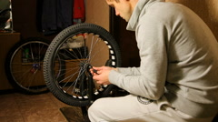 Bike maintenance. the young man tightens the spokes on the Bicycle wheel Stock Footage