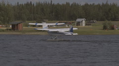 Plane rides on the water. Fairbanks, Alaska, Airport. - stock footage