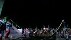 Bmx Rider making a bike Trick During The Dirt Jumping championship at night Stock Footage