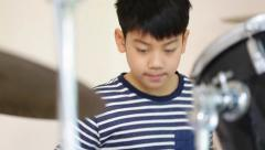 Closeup of asian child drummer practicing for a performance Stock Footage