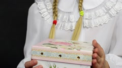 girl in white clothes received a gift on a black background - stock footage