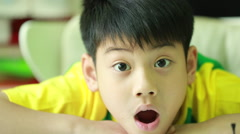 Young asian boy and emotions, portrait of happy kid looking at camera - stock footage