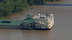 Flight past riverboat docked at pavilion on Mississippi near Baton Rouge, Stock Footage