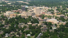Flight approaching downtown Lafayette, Louisiana; links with GCC116. Shot in Stock Footage