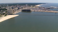 Flight along waterfront with wide view of Gulfport, Mississippi. Shot in 2007. - stock footage