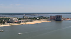 Flight along waterfront past Biloxi, Mississippi, with causeways in background. - stock footage