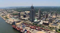 Orbit of downtown Mobile, Alabama, with Gulf of Mexico view; links to GCC127. Stock Footage