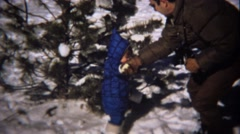 1974: Young girl blue coat winter snow dad helping. Stock Footage