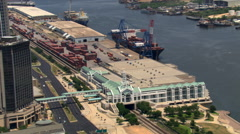Flight past waterfront and Mobile Convention Center, Mobile, Alabama. Shot in Stock Footage