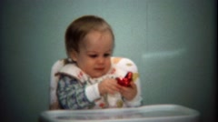 1974: Baby opening red chocolate Valentines Day heart gift. Stock Footage