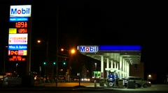 Mobil gas station fuel prices, 2016 - stock footage