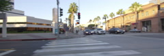 Left Side view of a Driving Plate: Car turns right from 4th Street onto Wilshire Stock Footage