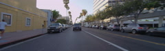 Rear view of a Driving Plate: Car turns right from 4th Street onto Wilshire Stock Footage