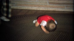 1974: Baby boy crawling head first on carpet rug. Stock Footage