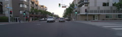 Front view of a Driving Plate: Car travels at sunset on Santa Monica Boulevard Stock Footage