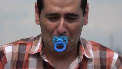 Adult Man Crying With Pacifier - stock footage