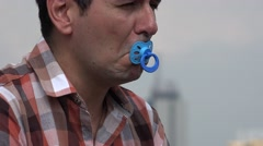 Infantile Man Using Baby Pacifier Stock Footage