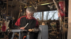 wood turner cutting shapes in wood - stock footage