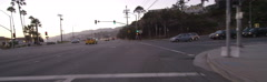 Front view of a Driving Plate: Car travels on Temescal Canyon Road at dusk to Stock Footage