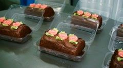 Packaging of cakes in the bakery fresh Stock Footage