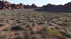 Fast flight skimming desert valley floor Stock Footage