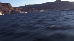 Fast, low flight over Lake Powell Stock Footage