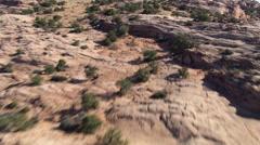 Low flight skimming Skeleton Mesa in Arizona - stock footage