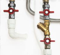Plastic pipes with ball valves - stock photo