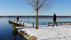 Footsteps in the snow by the lake Stock Footage