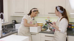 4K Female business partners in home bakery business preparing orders Stock Footage