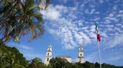Mexican flag and the Mérida Cathedral in Merida Stock Footage