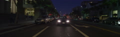 Rear view of a Driving Plate: Car travels on Santa Monica Boulevard in Santa Stock Footage