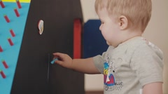 Little sweet artist chalk his home. Llittle boy is drawing on a blackboard Stock Footage