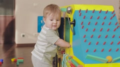 baby playing with a toy clock. Cute little child 2 years old - stock footage