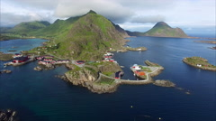 Red fishing huts in Mortsund on Lofoten islands in Norway, aerial view Stock Footage
