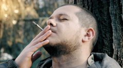 Drugs addict, man smoking weed, joint Stock Footage