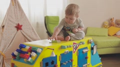 Stock Video Footage of baby playing with a toy clock. Cute little child 2 years old