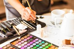 makeup cosmetics. compact powder, mineral foundation and  brushes - stock photo