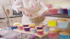 4K Woman with home bakery business preparing frosting for cupcakes Stock Footage